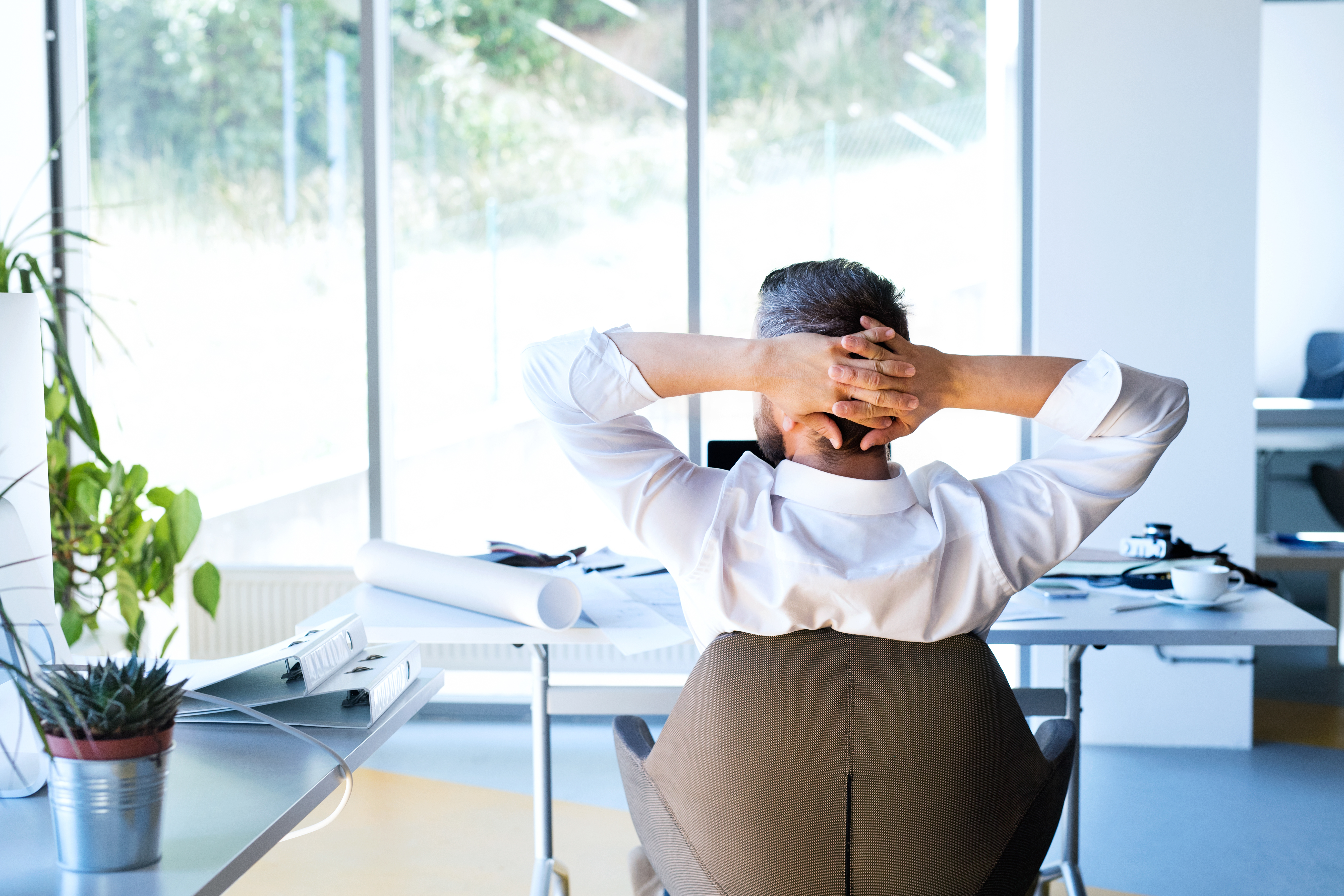 businessman-at-the-desk-in-his-office-resting-P2C76B3.jpg