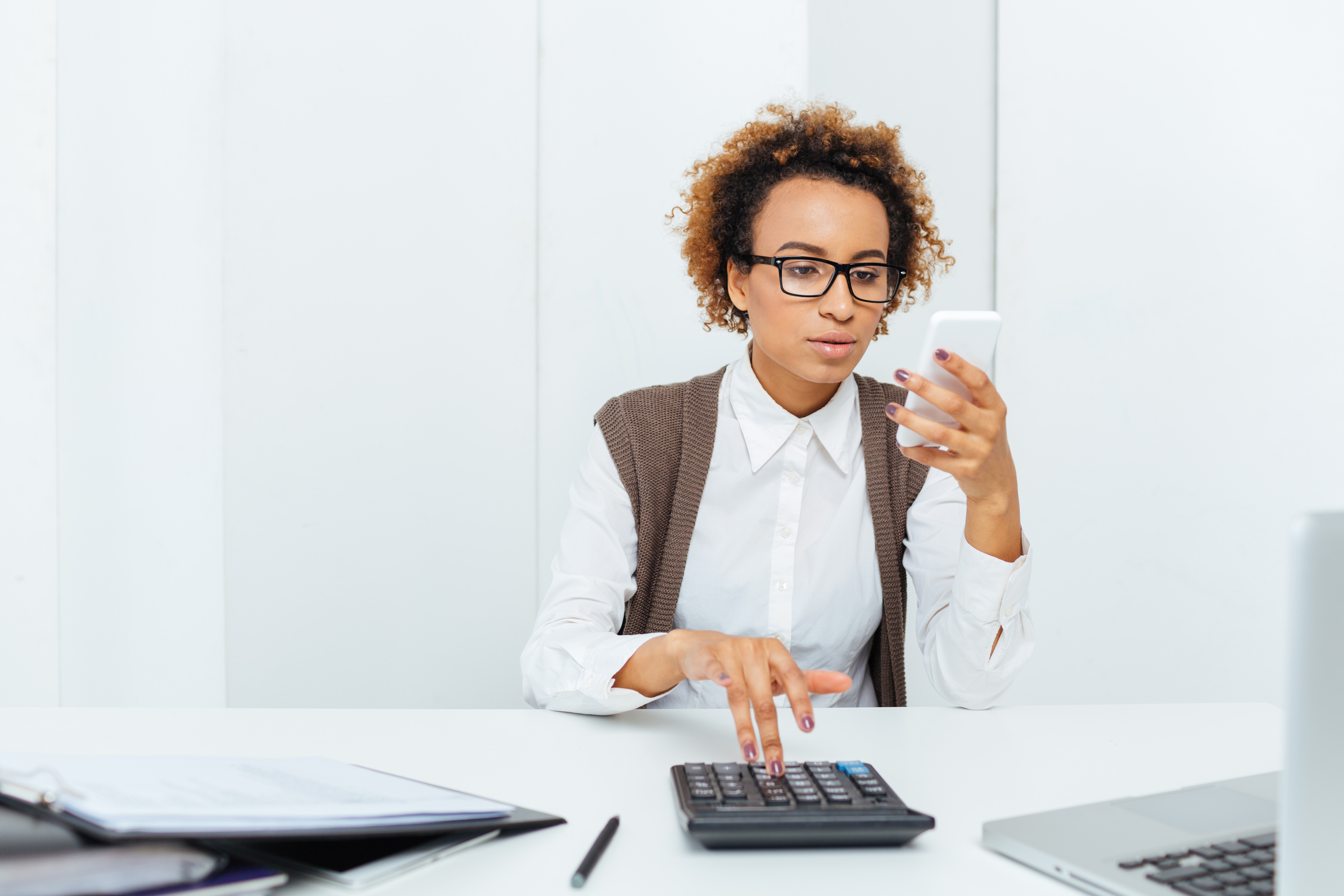 thoughtful-african-woman-accountant-working-with-PGZZT25.jpg
